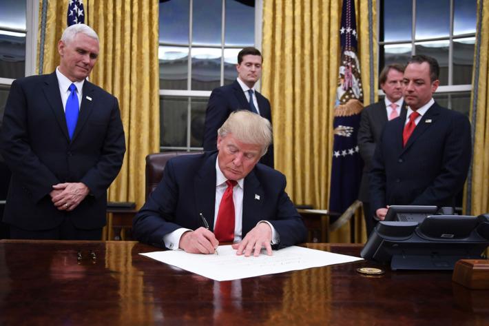 23-trump-signing-global-gag-rule-w710-h473